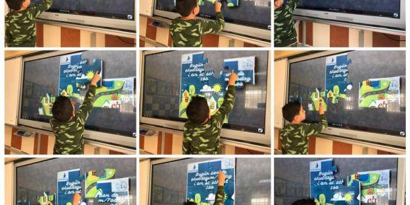Proje afişimizi puzzle oyunu yaptık doyasıya oynadık